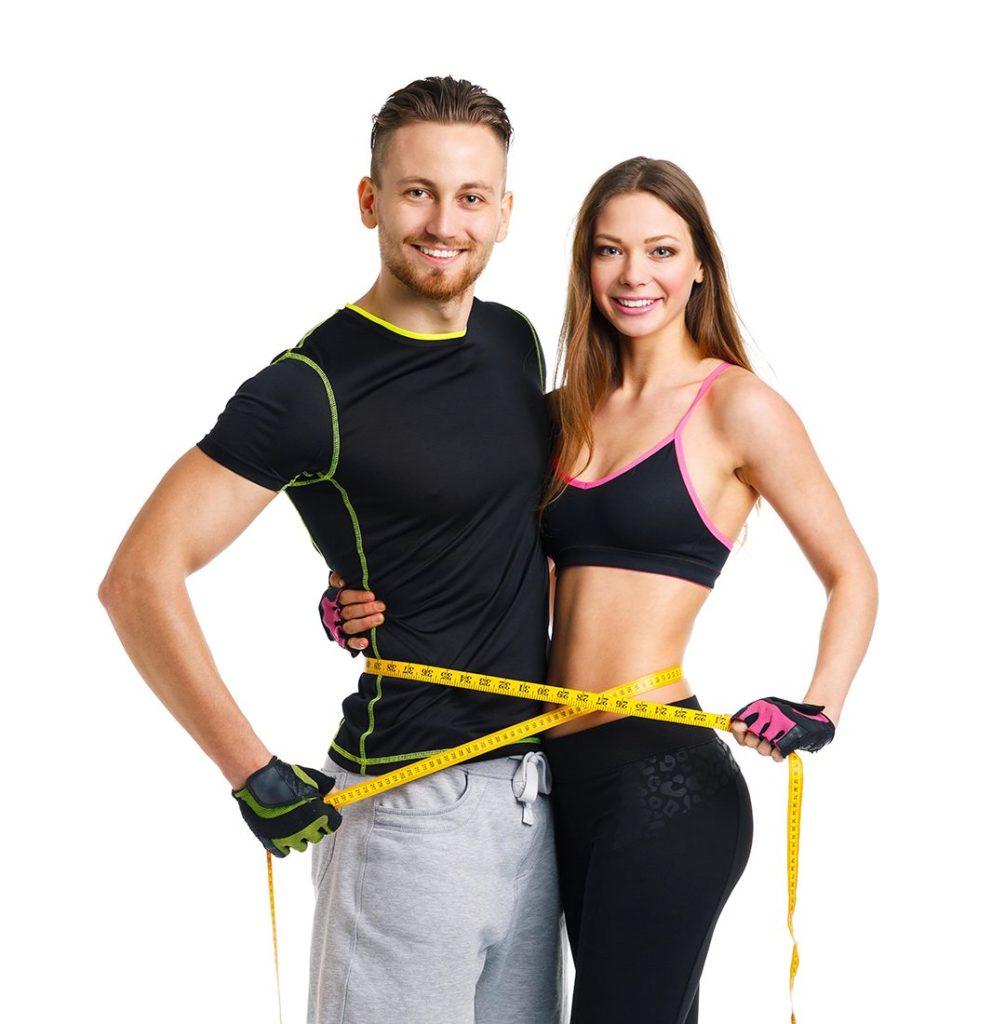 Frau und Mann machen Pilates Übungen